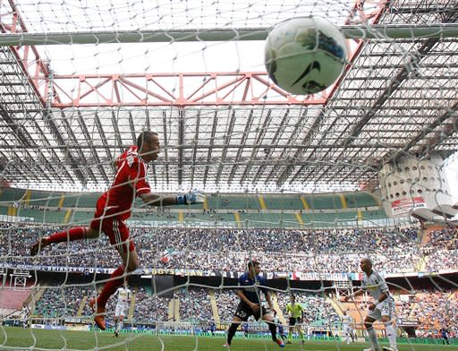 Inter Milan forward Mauro Zarate, center, of Argentina, scores a goal as Cesena goalkeeper Francesco Antonioli, left, tries to stop the ball during the Serie A soccer match between Inter Milan and Ces