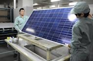 File picture shows workers assembling solar panels by hand at a factory in the eastern Chinese city of Wuxi. UN chief Ban Ki-moon made a call to double global consumption of renewable energy over the next two decades in order to ensure sustainable economic development