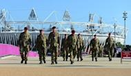 British soldiers walk near the Olympic stadium at the Olympic Park in London on July 22, 2012. The London 2012 Olympic Games begins on July 27, 2012. AFP PHOTO/Carl de Souza