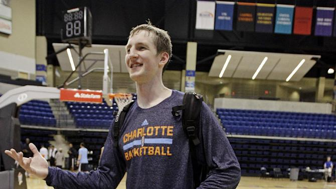 Charlotte Bobcats' Cody Zeller jokes with teammates after practice at NBA basketball training camp in Asheville, N.C., Wednesday, Oct. 2, 2013