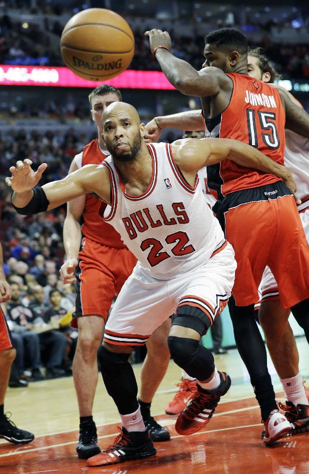 Chicago Bulls forward Taj Gibson (22) chases a loose ball during the second half of an NBA basketball game against the Toronto Raptors in Chicago on Saturday, Dec. 14, 2013. The Raptors won 99-77