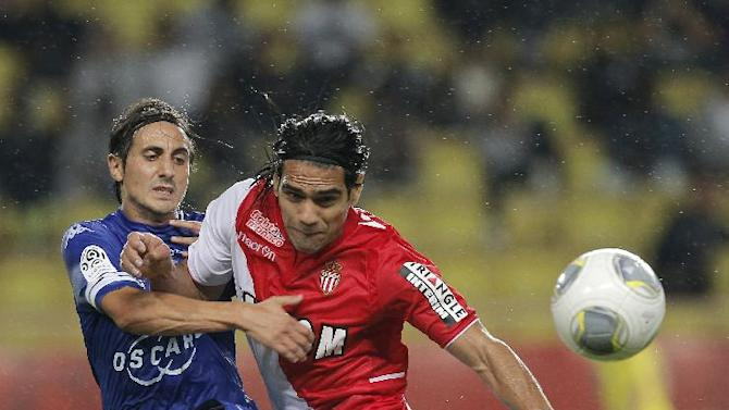 Monaco's Falcao of Colombia, right, challenges for the ball with Bastia's Fethi Harek of Algeria during their French League One soccer match, in Monaco stadium, Wednesday, Sept, 25, 2013