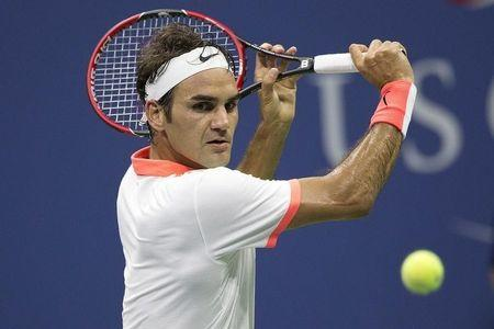 Federer of Switzerland returns a shot to Darcis of Belgium during their second round match at the U.S. Open Championships tennis tournament in New York