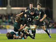 Ireland's hooker Richardt Strauss (2nd R) evades a tackle from South Africa's prop Jannie du Plessis (2nd L) during their Autumn International rugby union match at the Aviva stadium in Dublin. South Africa overturned a first half deficit and ill-discipline to open their November tour of the northern hemisphere with a deserved 16-12 victory
