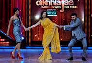 """Indian Bollywood actors Priyanka Chopra (left) and Ranbir Kapoor (right) pull on the arms of celebrity Madhuri Dixit during a promotion for their new film """"Barfi"""" in Mumbai on September 12. The film, India's entry for best foreign language film at next year's Oscars, has become the latest Bollywood movie to draw flak for allegedly plagiarising foreign hits in a 'mash-up' of ripped-off scenes"""