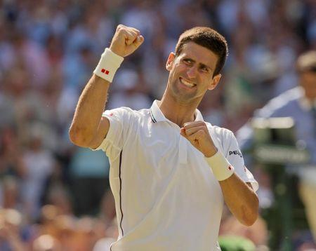 Jul 4, 2014; London, United Kingdom; Novak Djokovic (SRB) celebrates recording match point in his match against Grigor Dimitrov (BUL) on day 11 of the 2014 Wimbledon Championships at the All England Lawn and Tennis Club. Susan Mullane-USA TODAY Sports