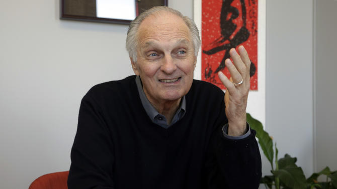 In this Friday, April 26, 2013 photo, actor Alan Alda speaks during an interview at Stony Brook University, on New York's Long Island. The film and television star is trying to encourage scientists of all disciplines to ditch the jargon and speak in plain English. (AP Photo/Richard Drew)