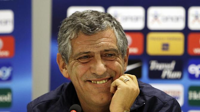 Greece's coach Fernando Santos smiles during a news conference in Bucharest, Monday, Nov. 18, 2013. The Greek national soccer team will play against Romania in their World Cup qualifying playoff second leg match on Tuesday