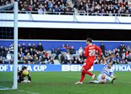 MK Dons' Ryan Harley scores against Queens Park Rangers during their 4-2 FA Cup fourth round win at Loftus Road in London on January 26, 2013
