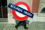 A man walks away from an auction at London's Olympia after buying a tube sign on April 25, 1995. The London Underground began celebrating its 150th birthday on Wednesday, creaking under the demand of four million daily passengers as it looked back to the opening of the world's first underground railway in 1863