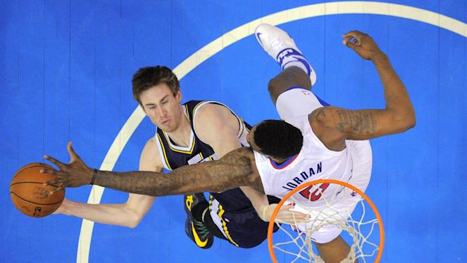 Utah Jazz guard Gordon Hayward, left, puts ups shot as Los Angeles Clippers center DeAndre Jordan defends during the first half of an NBA basketball game, Saturday, Feb. 1, 2014, in Los Angeles