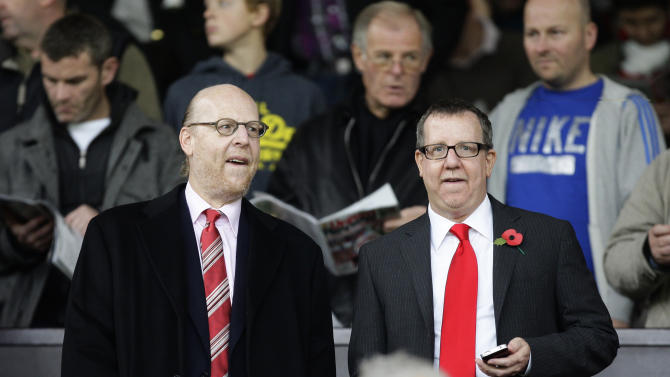 Manchester United directors Bryan Glazer, right, and Avram Glazer take to the stands before their team's 6-1 loss to Manchester City in their English Premier League soccer match at Old Trafford Stadium, Manchester, England, Sunday Oct. 23, 2011. (AP Photo/Jon Super)