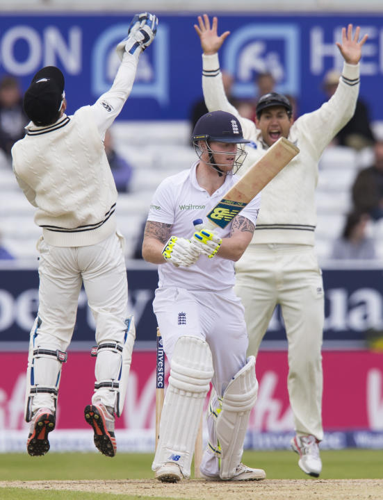 England's Ben Stokes, centre, reacts after being caught for  2 by New Zealand's Luke Ronchi, left, off the bowling of Kane Williamson on the fifth day of the second Test match between England