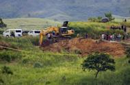 Military personnel search a shallow grave on November 24, 2009 in Ampatuan town, Maguindanao province, for the bodies of massacre victims. More than 100 suspects in the Philippines' worst political massacre are in custody after another member of a prominent political clan linked to the 57 killings was arrested, police said Wednesday.