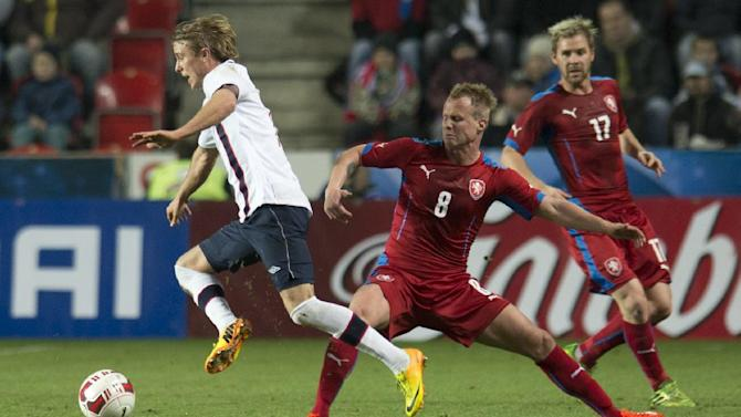 Per Ciljan Skjelbred from Norway challenges David Limbersky from the Czech Republic as Tomas Huebschman from the Czech Republic looks on, from left to right, during their friendly soccer match in Prague, Czech Republic, Wednesday, March 5, 2014. (AP Photo,CTK/Michal Kamaryt)