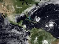 A 2009 satellite image shows tropical storms building up in the Atlantic and Pacific Oceans. Hurricane Miriam -- churning far off the Mexican coast in the Pacific Ocean -- has strengthened to a Category 2 storm, US forecasters say
