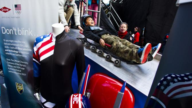 A boy rides Luge during an exhibition event by U.S. Olympic Committee at Times Square in New York