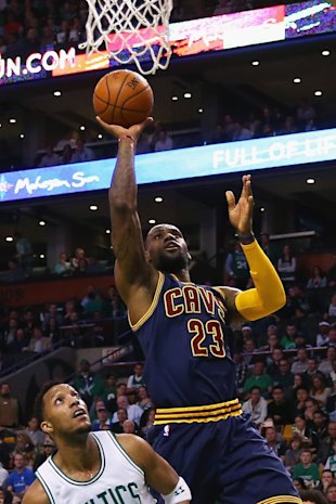 BOSTON, MA - APRIL 23:  LeBron James #23 of the Cleveland Cavaliers takes a shot over Evan Turner #11 of the Boston Celtics during the first quarter of their game in the first round of the 2015 NBA Playoffs at TD Garden on April 23, 2015 in Boston, Massachusetts. NOTE TO USER: User expressly acknowledges and agrees that, by downloading and/or using this photograph, user is consenting to the terms and conditions of the Getty Images License Agreement.  (Photo by Maddie Meyer/Getty Images)
