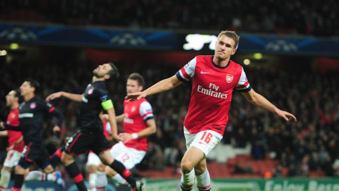 Aaron Ramsey, right, celebrates scoring Arsenal's third goal against Olympiacos
