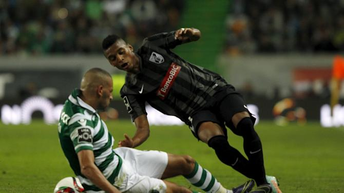Sporting's Islam Slimani fights for the ball with Guimaraes' Dalbert Estevao during their Portuguese Premier League soccer match at Alvalaxia stadium in Lisbon