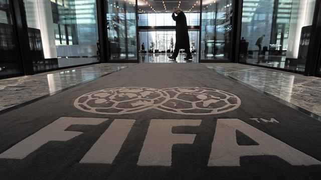 Football - FIFA acts over racism, Webb defends referees' position