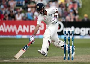Ajinkya Rahane makes his ground against New Zealand during the first innings on day two of the second international test cricket match at the Basin Reserve in Wellington, February 15, 2014. REUTERS/Anthony Phelps