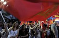 Supporters of the Greek Communist Party wave party flags and chant slogans, during a rally calling for Greece's exit from the Eurozone. Greece's president called Monday for talks on a technocrat government, seeking to resolve the crisis over a tough EU-IMF debt bailout which risks forcing the country into new elections and out of the eurozone