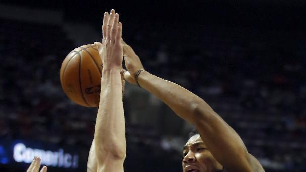 Indiana Pacers guard Orlando Johnson (11) passes the ball against Detroit Pistons guard Kyle Singler, left, during the first half of an NBA basketball game Tuesday, Nov. 5, 2013, in Auburn Hills, Mich