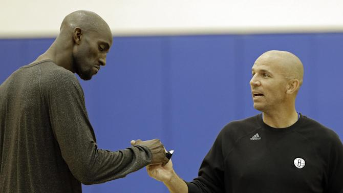 Brooklyn Nets' Kevin Garnett, left,  shakes hands with coach Jason Kidd during the team's NBA basketball training camp at Duke University in Durham, N.C., Tuesday, Oct. 1, 2013