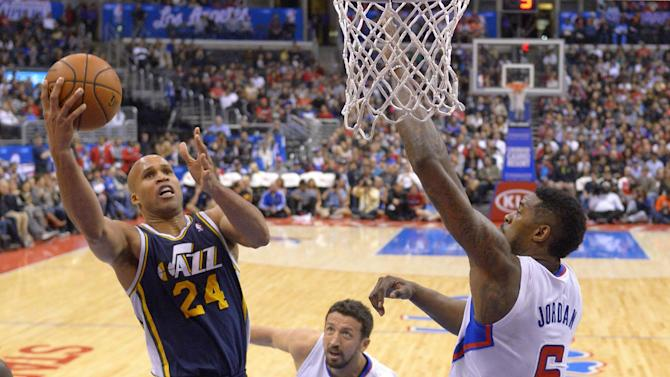 Utah Jazz forward Richard Jefferson, left, puts up a shot as Los Angeles Clippers center DeAndre Jordan, right, defends and forward Hedo Turkoglu, of Turkey, looks on during the second half of an NBA basketball game, Saturday, Feb. 1, 2014, in Los Angeles