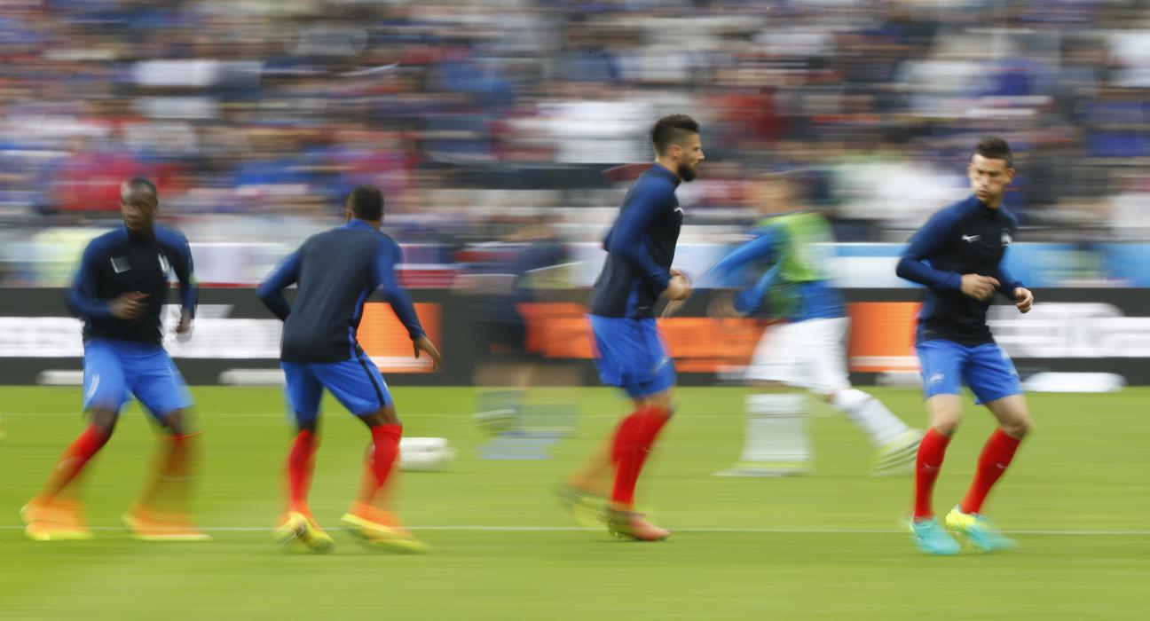 France's Olivier Giroud and Laurent Koscielny warm up before the game
