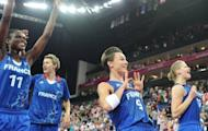 "French captain Celine Dumerc (C) and teammate Florence Lepron (R) celebrate after defeating Russia in the women's basketball semi-final at the London Olympics on August 9. ""We're very proud to face the USA,"" French captain Celine Dumerc said"