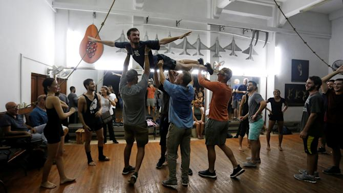 Players from Rice University's baseball team visit Cuba's National Ballet School in Havana
