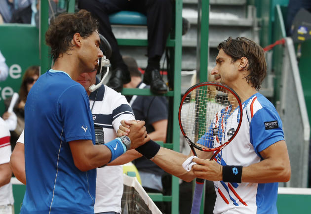 Rafael Nadal of Spain, left, and David Ferrer of Spain, right, shake hands after their quarterfinals match of the Monte Carlo Tennis Masters tournament in Monaco, Friday, April 18, 2014. Ferrer won 7-