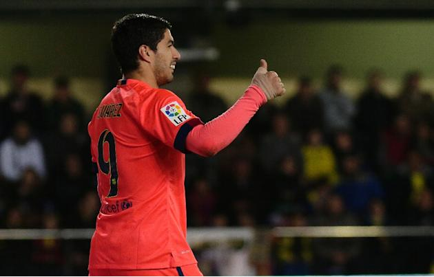 Barcelona's Luis Suarez celebrates scoring a goal during their Spanish Kings' Cup (Copa del Rey) match against Villarreal, at El Madrigal stadium in Villareal, on March 4, 2015