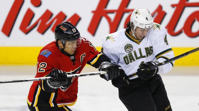 Calgary Flames' Iginla hits Dallas Stars' Dillon during their NHL hockey game in Calgary