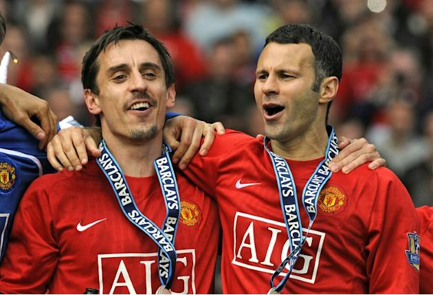Gary Neville (L) and Ryan Giggs celebrate winning the Premiership with Manchester United in 2009