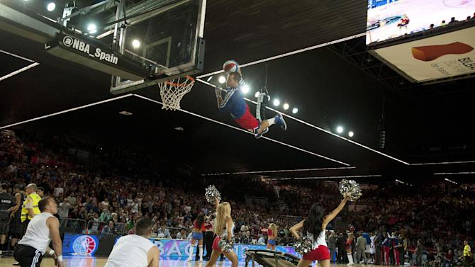 NBA entertainment perform during Philadelphia's 76ers and  Bilbao Basket, for the NBA Global basketball game, in Bilbao northern Spain on Sunday, Oct. 6, 2013
