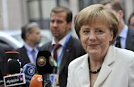 German Chancellor Angela Merkel speaks to media as she arrives for a second day of the European Union leaders summit in Brussels. A surprise deal to save the euro wrenched after an all-night summit of leaders of the 17 eurozone nations brought immediate relief to crisis-hit Italy and Spain and sent the single currency soaring