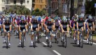 """The teammates of Wouter Weylandt pedal at the Giro d'Italia, Tour of Italy cycling race, in Livorno, Italy, Tuesday, May 10, 2011, during a fourth stage honoring the Leopard-Trek cyclist who died in a high-speed crash. The Leopard-Trek team will continue to ride in the Giro d'Italia despite the death of cyclist Wouter Weylandt. The 26-year-old Belgian crashed Monday during a descent after clipping a wall during the third stage of the race and died at the scene despite medical staff trying to revive him for 40 minutes. """"We will start out of respect for the family of Weylandt and also to share our grief with the world of cycling,"""" Leopard Trek general manager Brian Nygaard said Tuesday."""