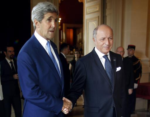 US Secretary of State John Kerry (L) is greeted by France's Foreign Minister Laurent Fabius (R) in Paris, on July 26, 2014
