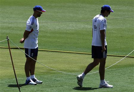 England's cricket team captain Cook walks away from teammate Prior during a training session in Brisbane