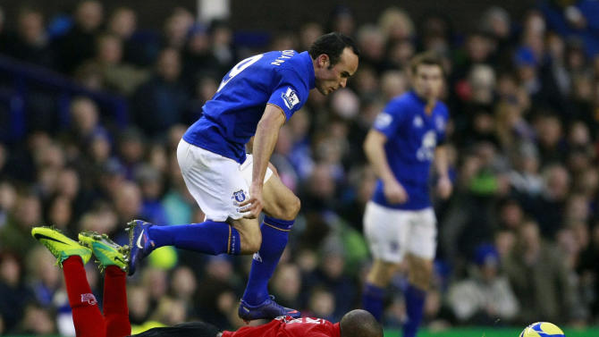 Everton's Landon Donovan, top, vies for the ball against Tamworth's Danny Thomas during their English FA Cup third round soccer match at Anfield, Liverpool, England, Saturday Jan. 7, 2012. (AP Photo/Tim Hales)
