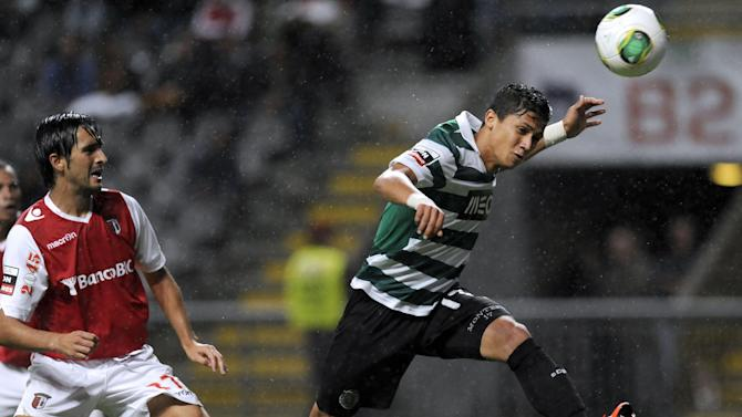 Sporting's Fredy Montero, from Colombia, goes for the ball past Sporting Braga's Custodio Castro, left, during their Portuguese League soccer match at the Municipal Stadium, in Braga, Portugal, Saturday Sept. 26, 2013. Montero scored once in Sporting's 2-1 victory