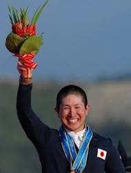 Kenki Sato celebrates on the podium with his two gold medals won in the individual and team jumping events at the Asian Games in November 2010. Sato has been training with reigning world and European eventing champion Michael Jung at a stable near Stuttgart in preparation for the London Games