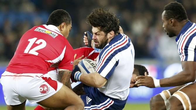 France's Yannick Forestier is tackled by Tonga's Sione Piukala during their rugby union test match in Le Havre