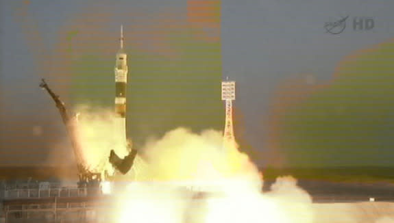 American, Canadian, and Russian Spaceflyers Launch to Space Station