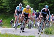 Yellow jersey leader British Bradley Wiggins (C) rides in the sixth stage of the 64rd edition of the Dauphine Criterium cycling race between Saint-Aban-Leysse and Morzine, French Alps