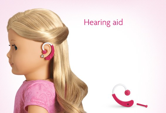 An American Girl doll with a customizable hearing aid. (americangirl.com)