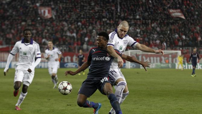 Anderlecht's Nuytinck challenges Olympiakos' Olaitan during their Champions League soccer match in Athens